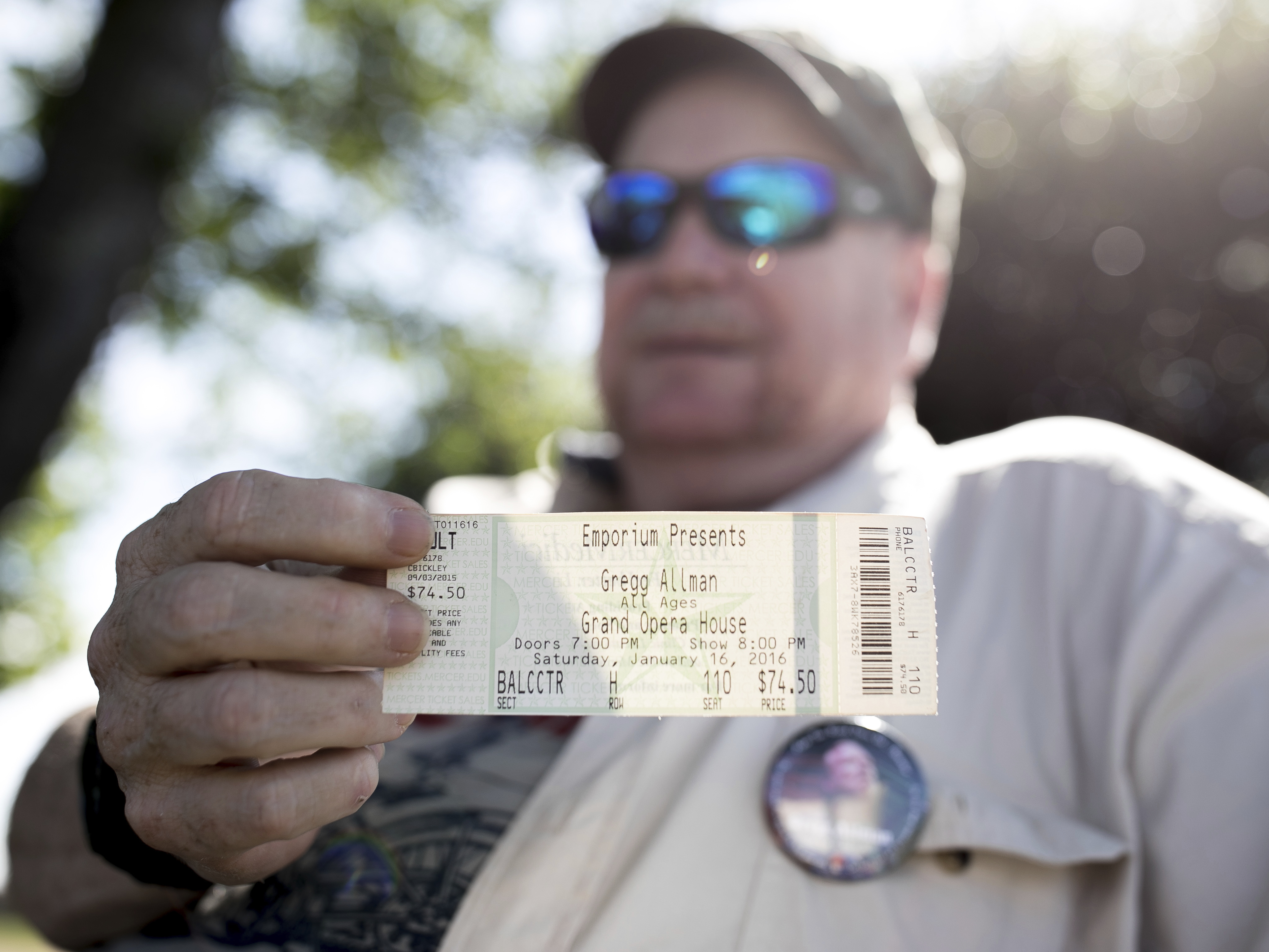 Mark Elliott shows a concert ticket from the last Gregg Allman concert he attended, Saturday, June 3, 2017, in Macon, Ga. Family, friends and fans on Saturday will say goodbye to the music legend, who died over the Memorial Day weekend at the age of 69. (AP Photo/Branden Camp)