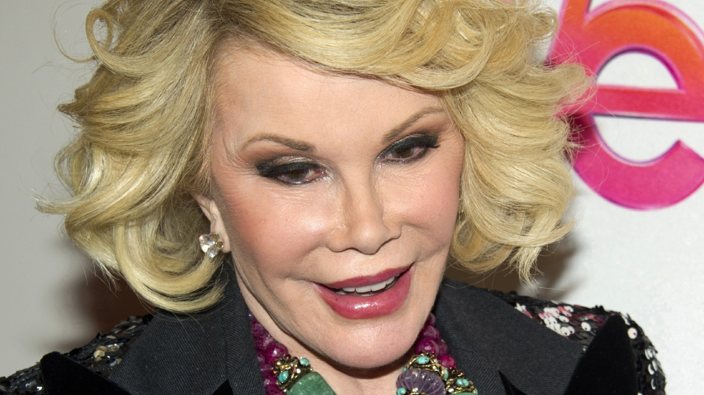 "In this Jan. 19, 2012, file photo, Joan Rivers attends a screening of the Season 2 premiere of WE TV's ""Joan & Melissa: Joan Knows Best?"" in New York. Two police officials say Rivers has been rushed in cardiac arrest from a doctor's office to a New York City hospital, Thursday, Aug. 28, 2014. (AP Photo/Charles Sykes, File)"