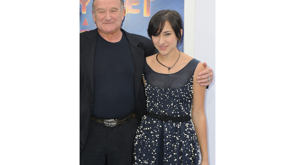 "This Nov. 13, 2011 file photo shows actor Robin Williams, left, and his daughter, Zelda at the premiere of ""Happy Feet Two"" in Los Angeles. (AP Photo/Katy Winn, File)"