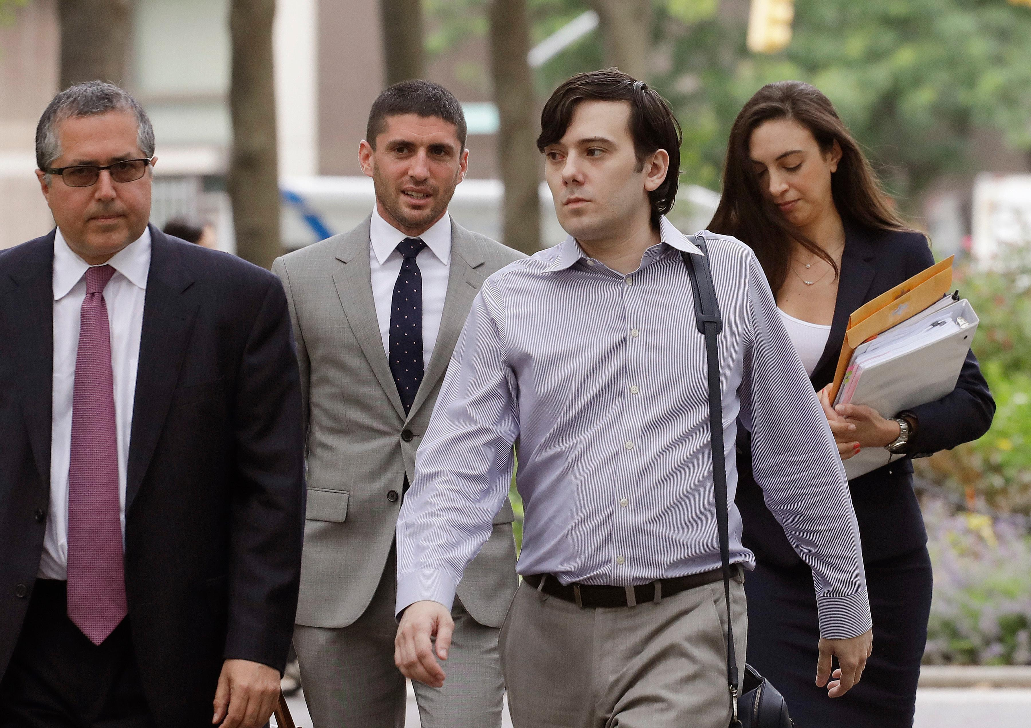 FILE - In this Monday, June 19, 2017, file photo, former Turing Pharmaceuticals CEO Martin Shkreli, second from right, arrives at Brooklyn federal court with members of his legal team, in New York, for a pretrial conference in his securities fraud trial. Shkreli's trial begins Monday, June 26, 2017. (AP Photo/Mark Lennihan, File)