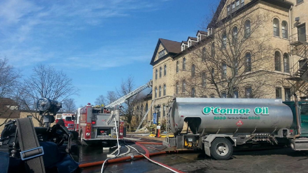Firefighters battle a fire at St. Lawrence Seminary in Mt. Calvary, March 8, 2014. (WLUK/Chris Bourassa)