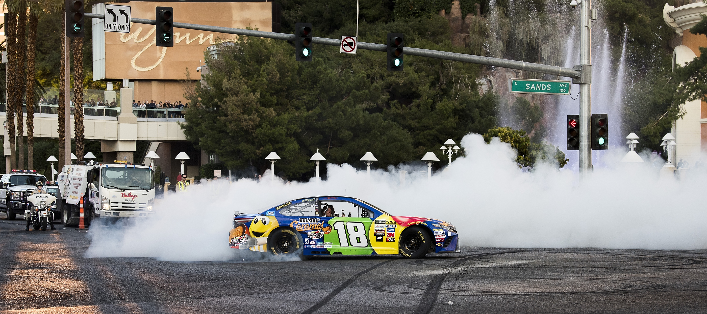 Las Vegan Kyle Busch spins out in his #18 M&M's Caramel Toyota Camry at the NASCAR Victory Lap on the Las Vegas Strip at the intersection of Las Vegas Blvd. and Spring  Mountain Road on Wednesday, Nov. 29, 2017. CREDIT: Mark Damon/Las Vegas News Bureau