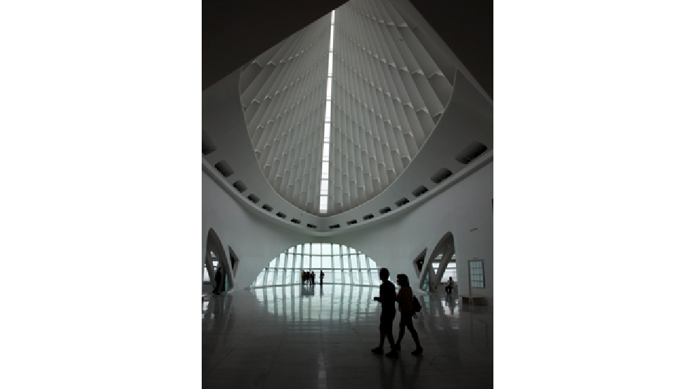 People walk through the Milwaukee Art Museum Tuesday, Aug. 17, 2010, in Milwaukee. (AP Photo/Morry Gash)