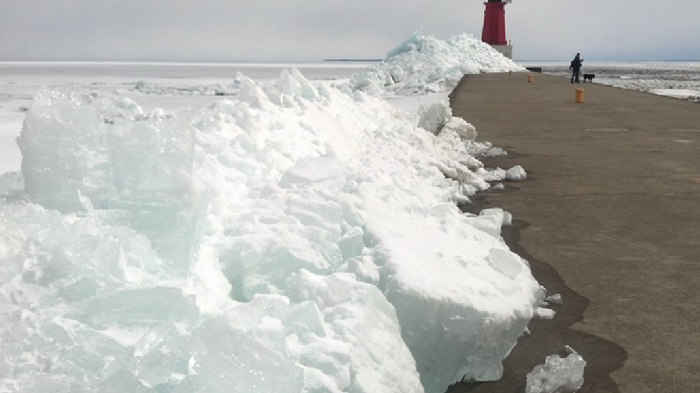 Ice shoves pile up along the shore of Lake Michigan in Menominee, Mich., April 15, 2014. (WLUK/Eric Peterson)