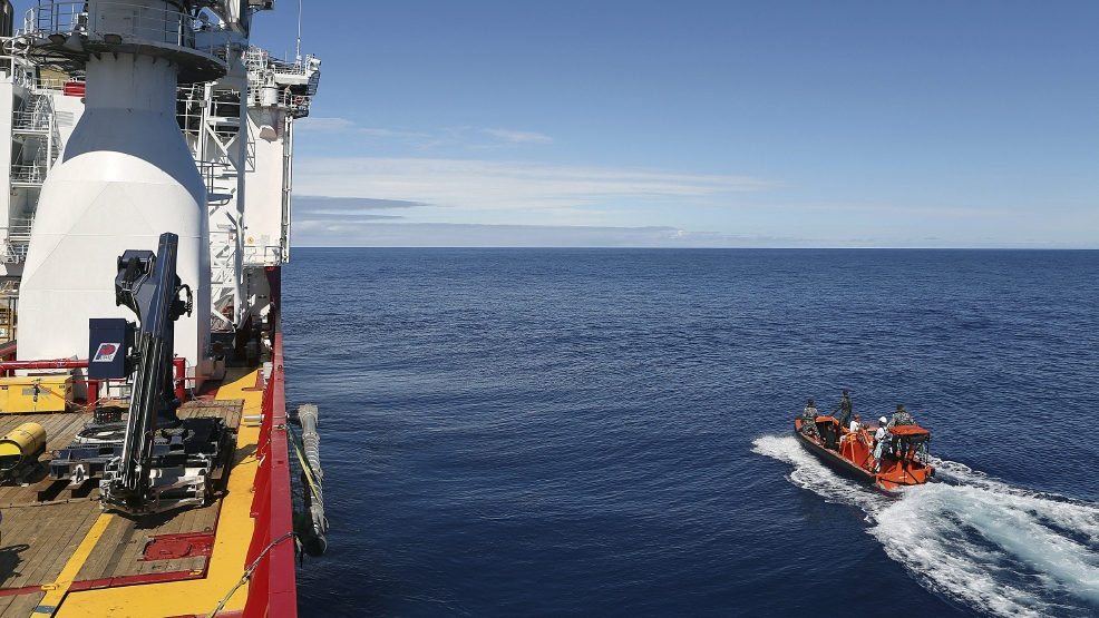 In this April 7, 2014 photo provided by the Australian Defense Force a fast response craft manned by members ofthe Australian Defense's ship Ocean Shield is deployed to scan the water for debris of the missing Malaysia Airlines Flight 370 in the southern Indian Ocean. Up to 14 planes and as many ships were focusing on a single search area covering 77, 580 square kilometers (29,954 square miles) of ocean, 2,270 kilometers (1,400 miles) northwest of the Australian west coast city of Perth, Australia. (AP Photo/Australian Defense Force, LSIS Bradley Darvill)