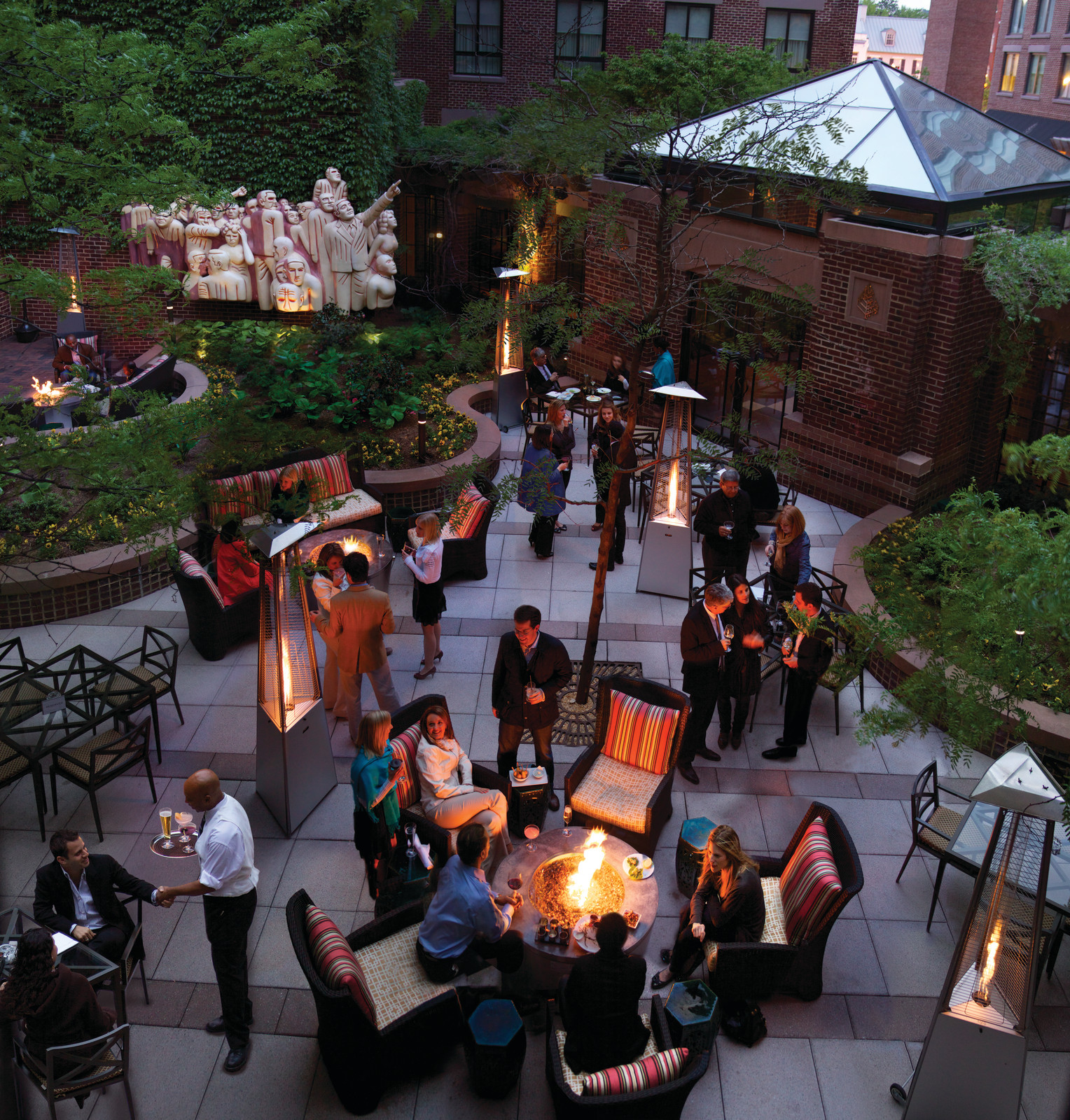 The Four Seasons' temple to red meat and whiskey has four—count 'em, four—patios where you can sip and smoke all winter. (Image: Courtesy The Four Seasons)