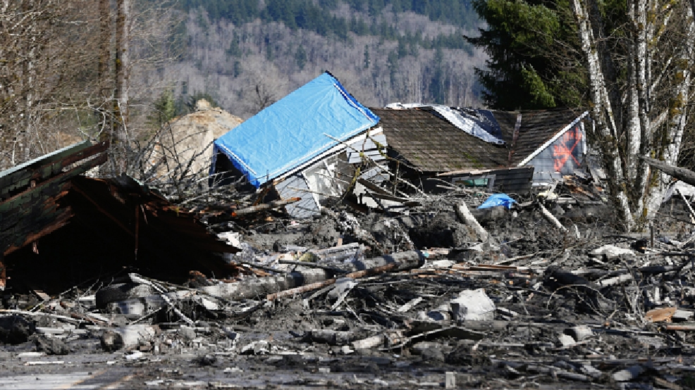 A house is seen destroyed in the mud on Highway 530 next to mile marker 37 on Sunday, March 23, 2014, the day after a giant landslide occurred near mile marker 37 near Oso, Washington. (AP Photo/The Seattle Times, Lindsey Wasson, Pool)