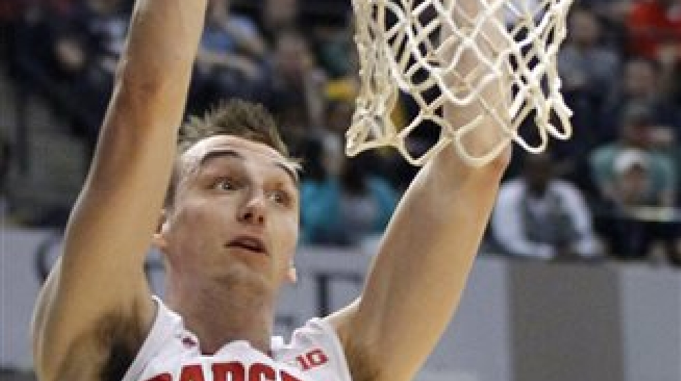 Wisconsin forward Sam Dekker dunks in the first half of an NCAA college basketball game against Michigan State in the semifinals of the Big Ten Conference tournament Saturday, March 15, 2014, in Indianapolis. (AP Photo/Kiichiro Sato)