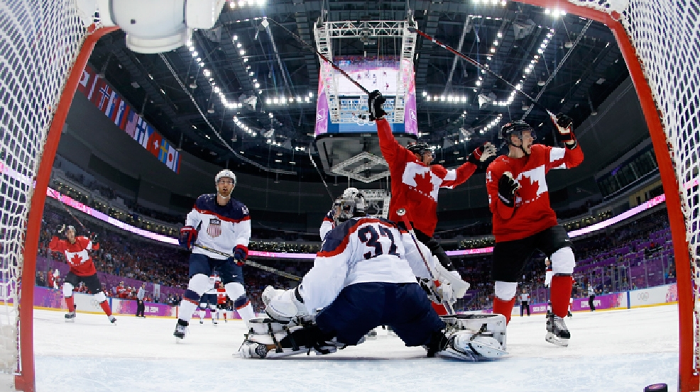Canada forward Benn Jamie reacts after scoring a goal in front of USA goaltender Jonathan Quick of a men's semifinal ice hockey game at the 2014 Winter Olympics, Friday, Feb. 21, 2014, in Sochi, Russia. (AP Photo/Julio Cortez, Pool)