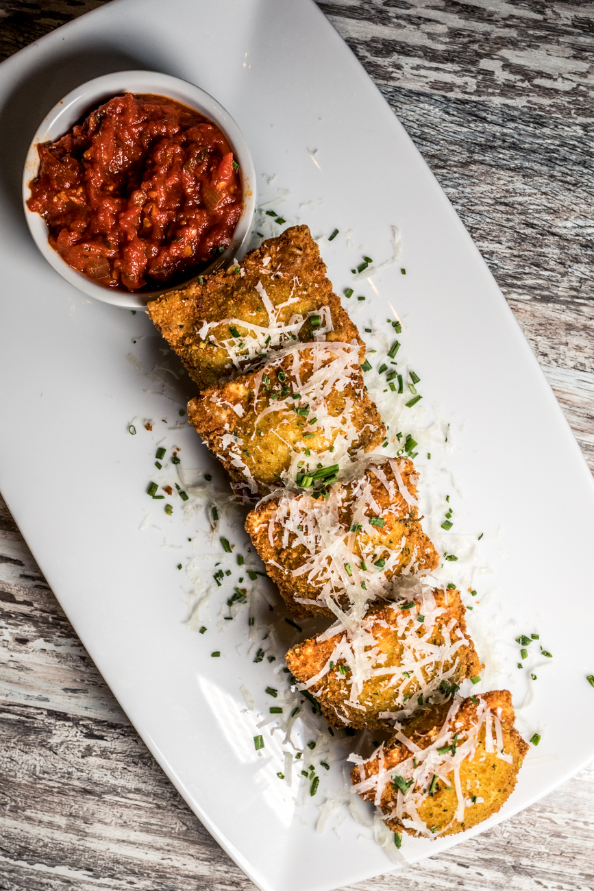 Toasted Ravioli stuffed with whipped ricotta and spinach and served with marinara for dipping / Image: Catherine Viox // Published: 4.21.20