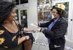 "Yeni Sleidi, known as the ""weed fairy,"" right, buys marijuana from a dealer, who declined to be identified, in Seattle's Capitol Hill neighborhood Wednesday, May 28, 2014, where this past weekend Sleidi posted 50 fliers with nuggets of marijuana taped to them. Sleidi, a 23-year-old who works in social media, has been visiting Seattle from New York where last year she did a similar posting, albeit anonymously. (AP Photo/Elaine Thompson)"