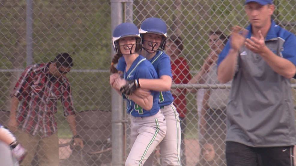 Green Bay Notre Dame celebrates the winning run against Shawano in a WIAA softball regional match-up.