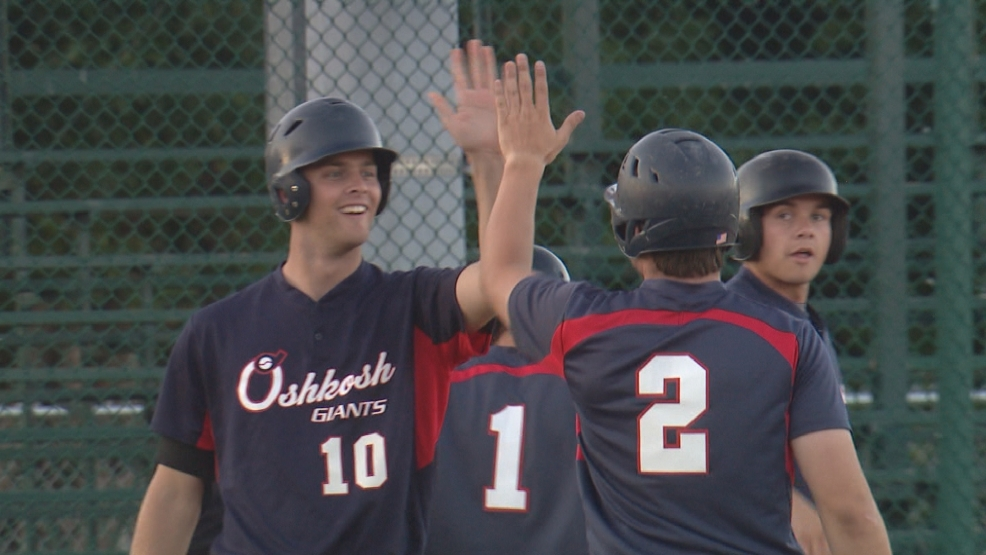 Oshkosh Giants Mike Becker and Davis Yach celebrate after crossing home plate.