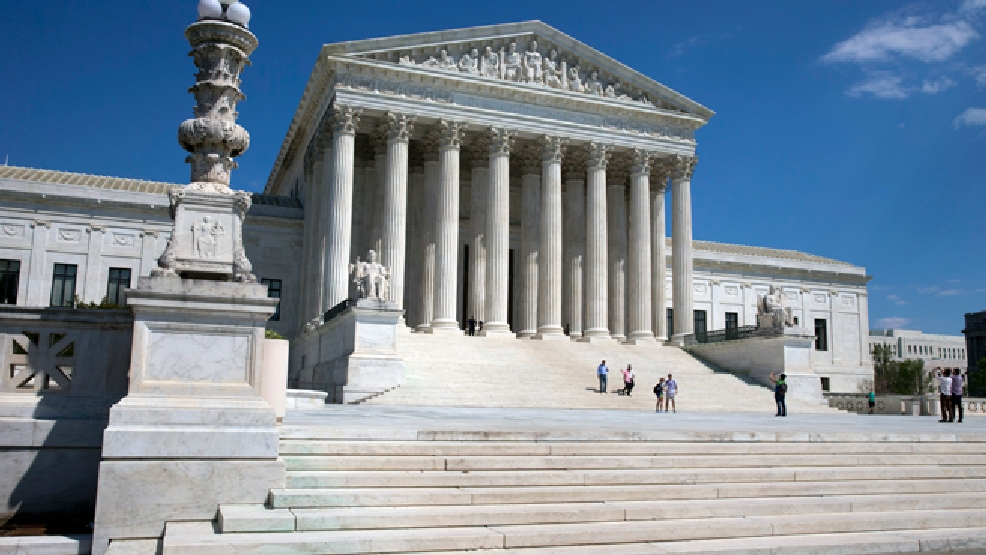 FILE - In this April 26, 2014 file photo, people walk on the steps of the U.S. Supreme Court in Washington. (AP Photo/Jacquelyn Martin)