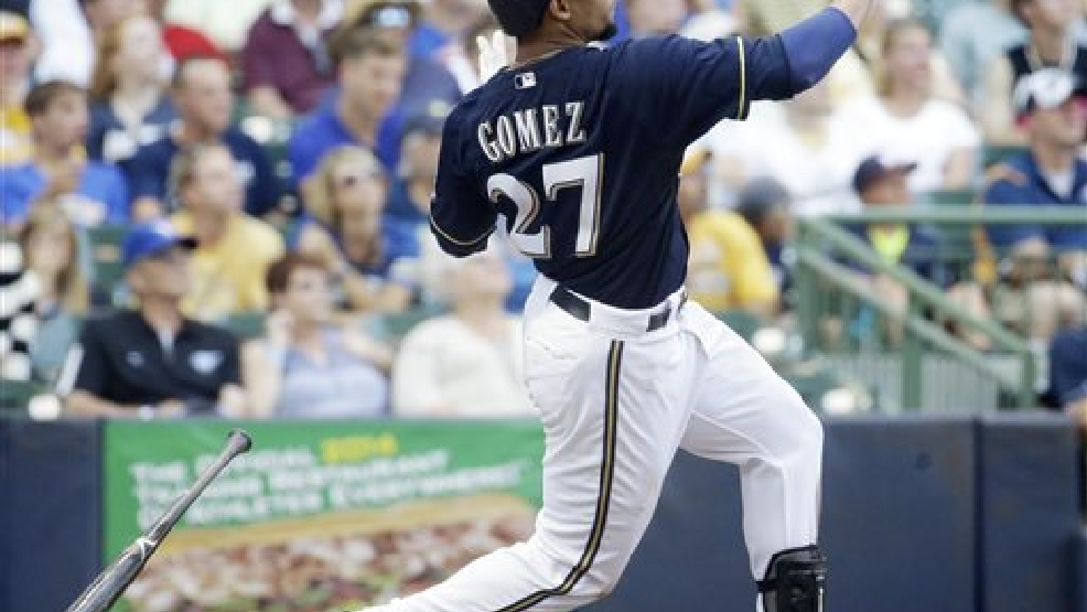 Milwaukee Brewers' Carlos Gomez hits a two-run home run during the sixth inning of a baseball game against the Toronto Blue Jays Wednesday, Aug. 20, 2014, in Milwaukee. (AP Photo/Morry Gash)