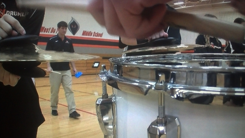 West De Pere Middle School Band Director Dave Schepp leads the Phantom Drumline