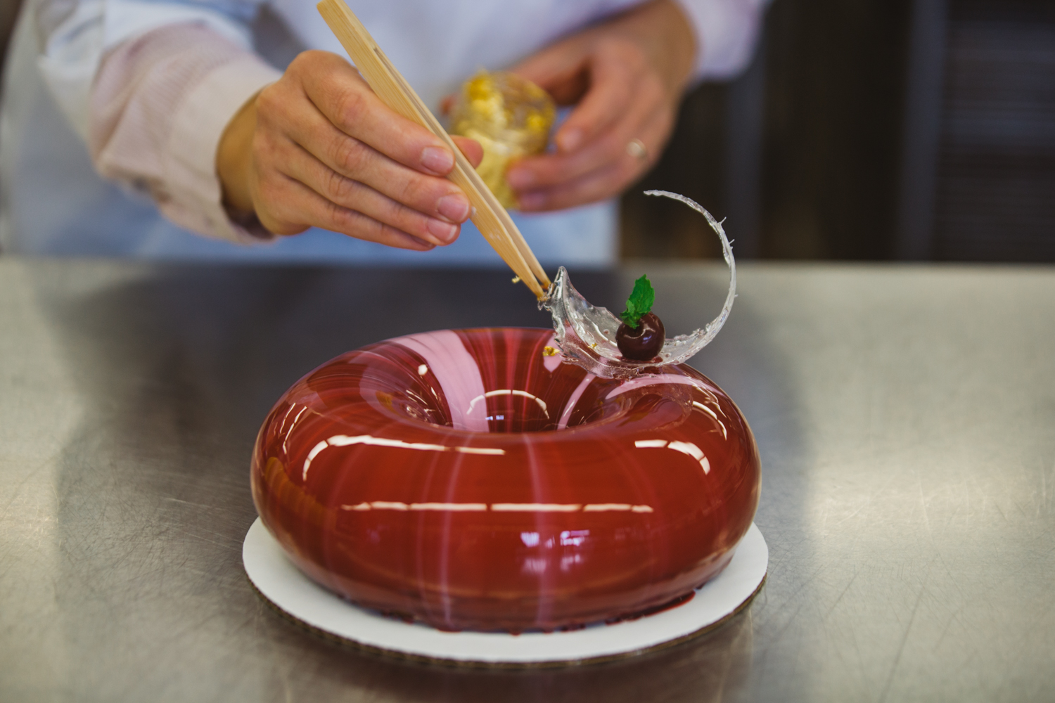<p>Slowly and delicately poured over delicious mousse cakes, mirror glazing takes cake aesthetic to a whole new level. At Mousse Boutique, Anastasia Stratulat is a master as she carefully designs beautiful edible art pieces through her high quality minimalist designs. (Image: Ryan McBoyle / Seattle Refined)</p>