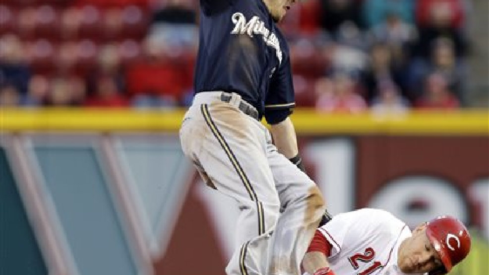 Milwaukee Brewers second baseman Scooter Gennett tries to tag Cincinnati Reds' Todd Frazier (21) stealing second base in the fourth inning of a baseball game, Thursday, May 1, 2014, in Cincinnati. (AP Photo/Al Behrman)