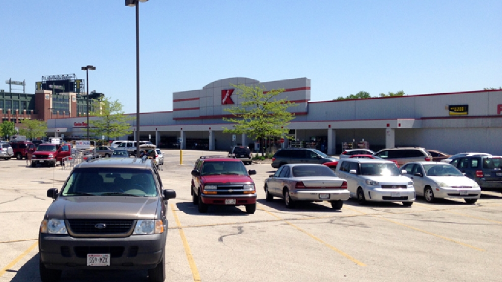 The Kmart store in Ashwaubenon, with Lambeau Field in the background, is seen May 30, 2014. (WLUK/Todd Berry)