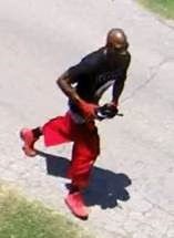 One possible suspect is described by police as a black male, 25-30 years old, bald, wearing red gloves, shoes and shorts, with a black t-shirt (KTUL).