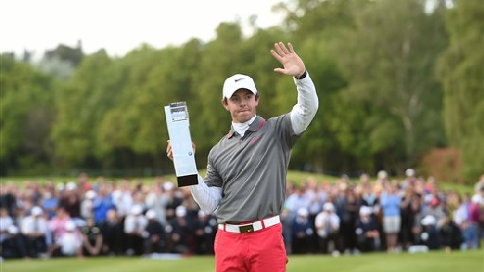 Northern Ireland's Rory Mcilroy with the trophy after he won the BMW PGA Championship at the Wentworth Club, Virginia Water, England, Sunday, May 25, 2014.  (AP Photo/ PA, Adam Davy)