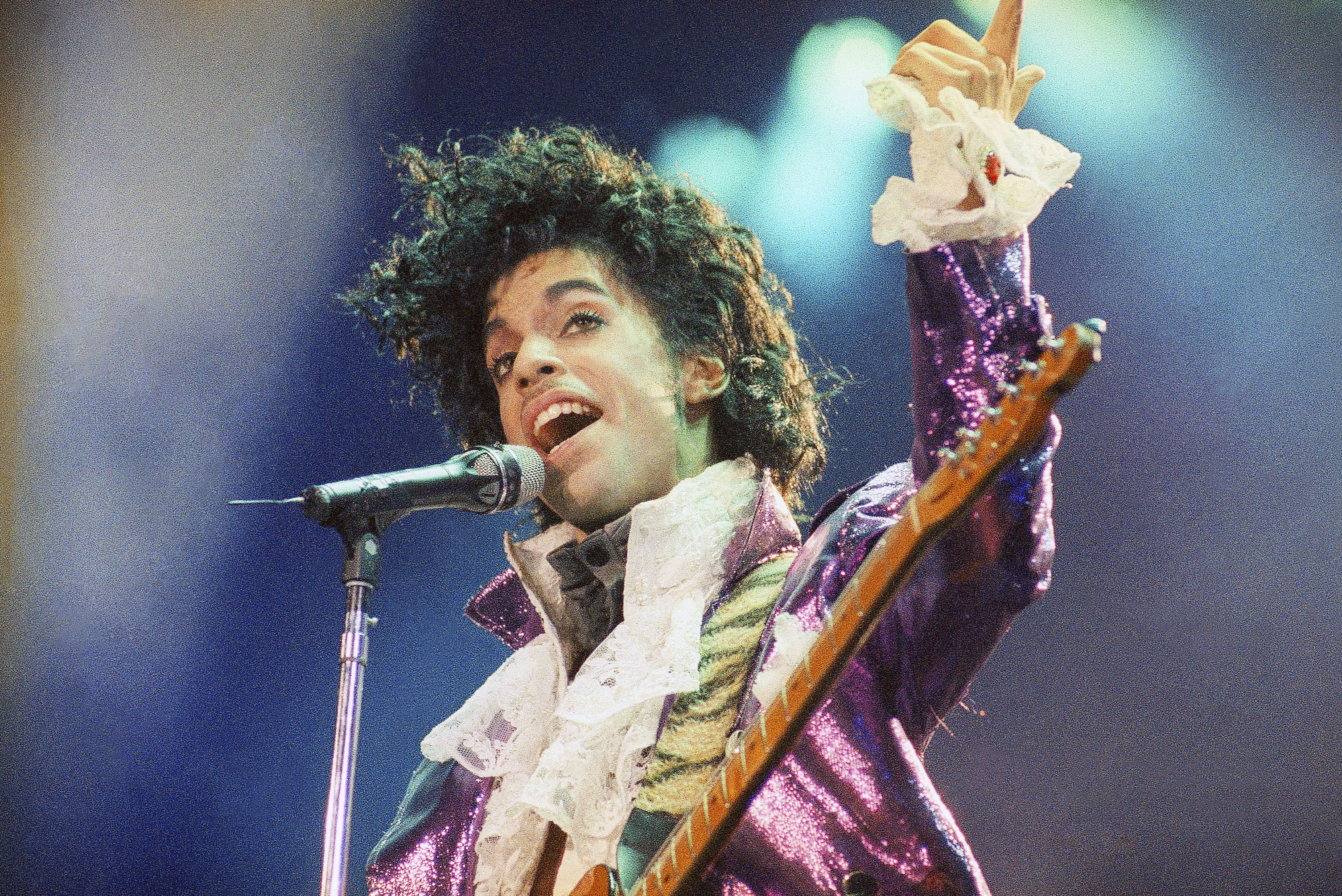 FILE - In this Feb. 18, 1985 file photo, Prince performs at the Forum in Inglewood, Calif. A new song from Prince's late father, produced at Paisley Park, is being released Thursday, June 29, 2017, to celebrate what would have been his 101th birthday.  (AP Photo/Liu Heung Shing, File)