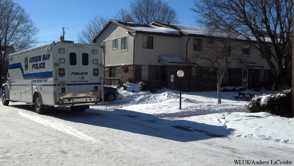 Green Bay police investigate suspicious deaths at an apartment building in the 500 block of Fisk St., Jan. 21, 2014.