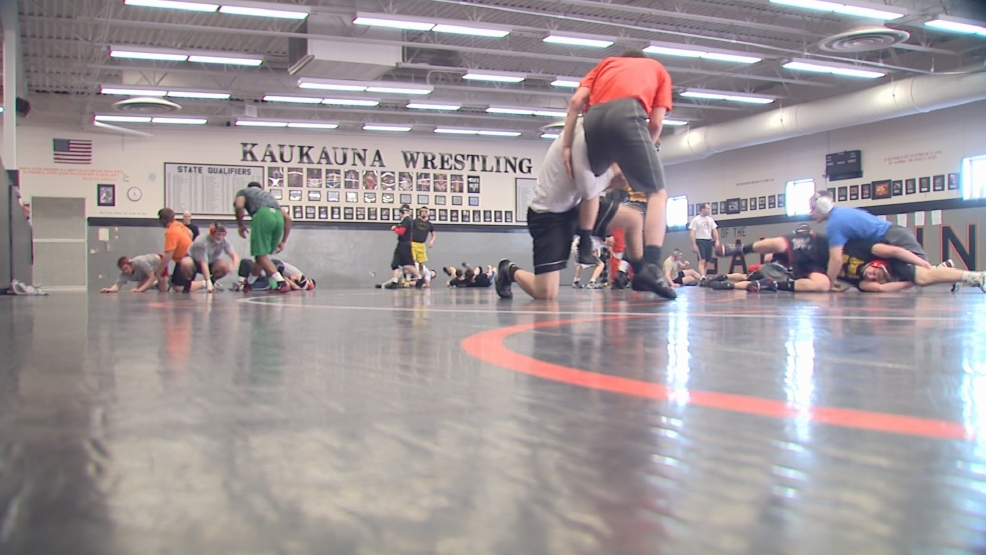 The Kaukauna wrestling team practices prior to the state tournament.