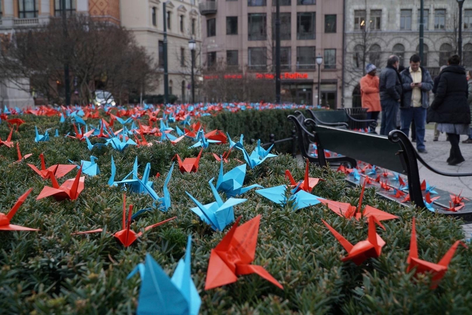 A thousand paper cranes installed by anti-nuclear activists in front of the Norwegian parliament in Oslo, Saturday, Dec. 9, 2017.   The International Campaign to Abolish Nuclear Weapons is the recipient on this year's Nobel Peace Prize, has installed 1,000 paper cranes made by children in Hiroshima, the site of the world's first atomic bomb attack in Japan, outside the Norwegian Parliament ahead of formally receiving the prize. (AP Photo/David Keyton)