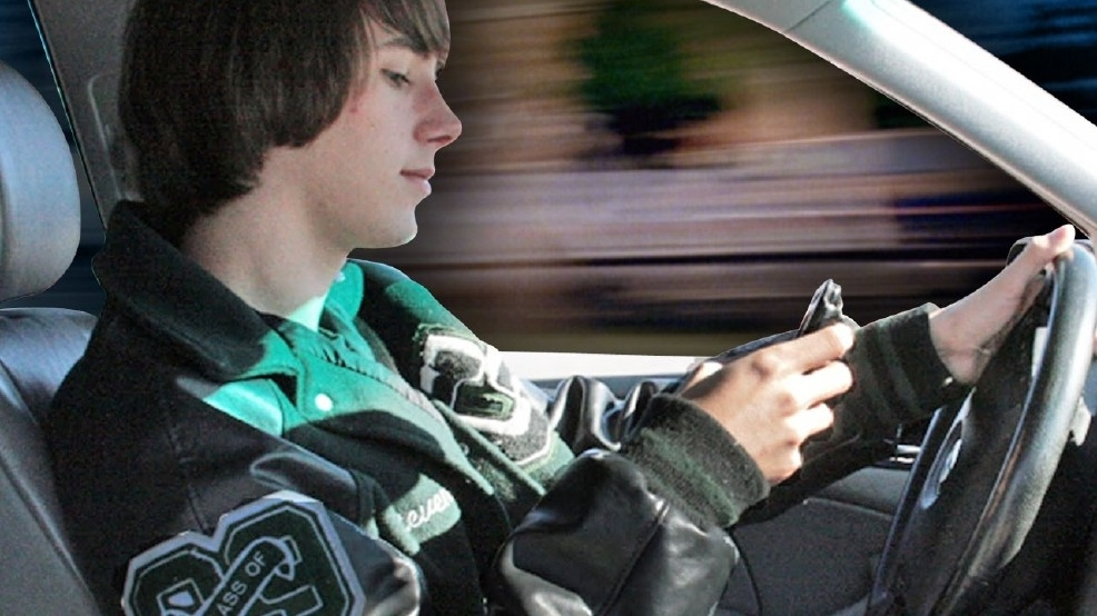 Holding a smart phone while driving could soon be a crime in WA