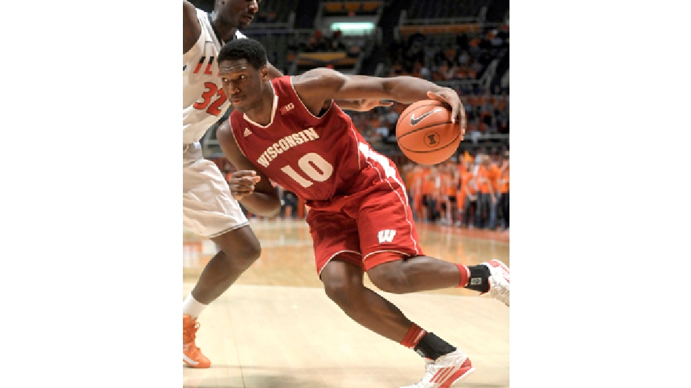 Wisconsin forward Nigel Hayes (10) drives on Illinois forward/center Nnanna Egwu (32) in the second half of an NCAA college basketball Tuesday, Feb. 4, 2014, in Champaign, Ill. Wisconsin won 75-63. (AP Photo/Rick Danzl)