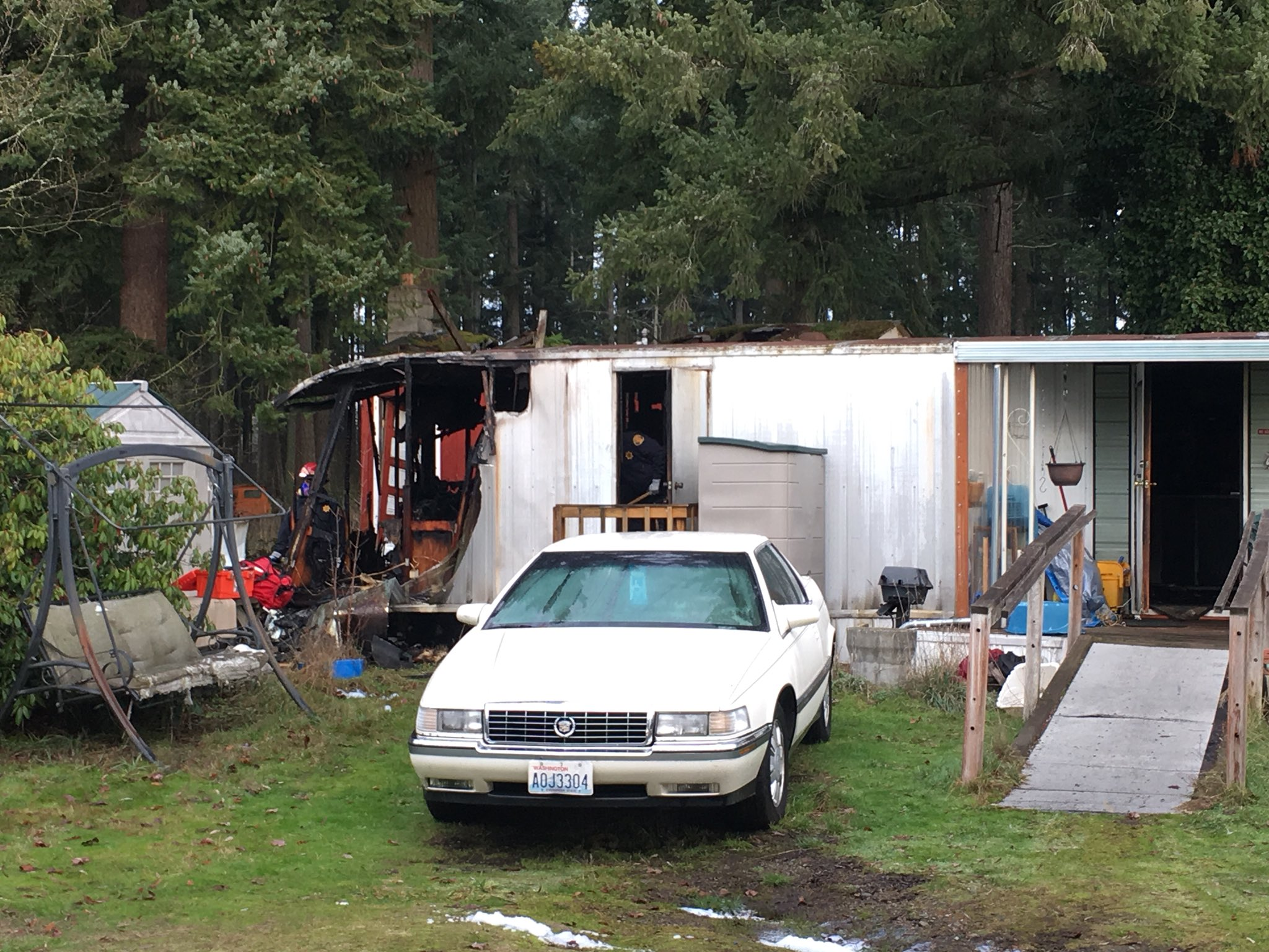 A fire burns a mobile home in Spanaway on Jan. 2, 2018 (KOMO Photo)
