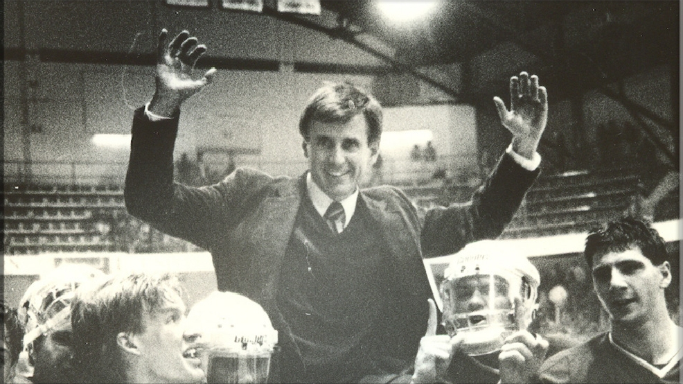 Merrimack coach Ron Turner celebrates with his players. (Courtesy Merrimack College Archives)