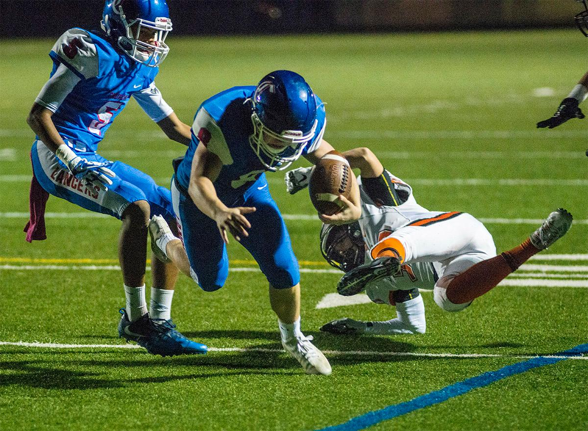 Churchill Lancers Dalton McDaniel (#8) carries the ball for a gain. Churchill defeated Crater 63-21 on Friday at their homecoming game. Churchill remains undefeated with a conference record of 9-0. Photo by Rhianna Gelhart, Oregon News Lab