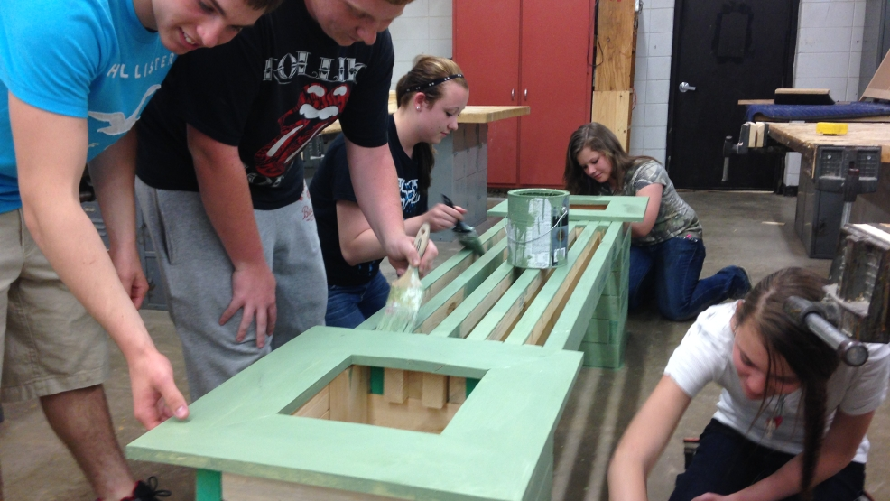 Little Wolf High School students build benches to improve downtown.