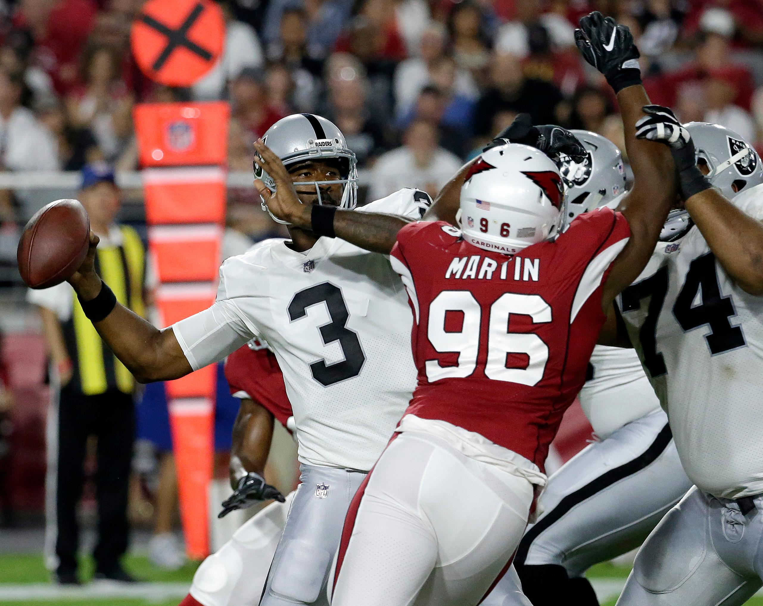 Oakland Raiders quarterback EJ Manuel (3) throws under pressure from Arizona Cardinals linebacker Kareem Martin (96) during the first half of an NFL preseason football game, Saturday, Aug. 12, 2017, in Glendale, Ariz. (AP Photo/Rick Scuteri)