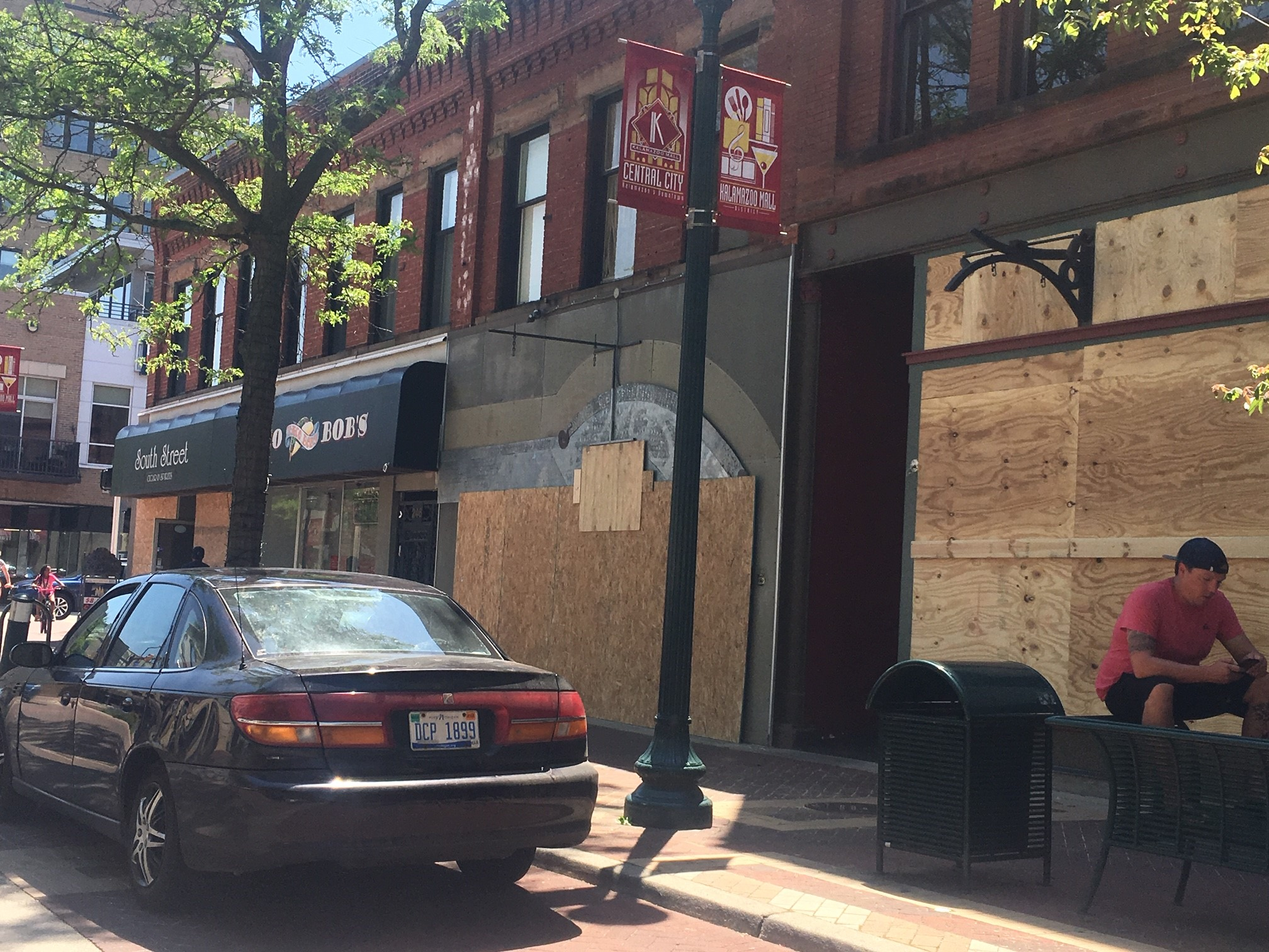 Downtown Kalamazoo businesses begin boarding up windows and doors Tuesday, June 2, 2020, after the city declared it will enforce a curfew starting at 7 p.m. (WWMT/Mike Krafcik)