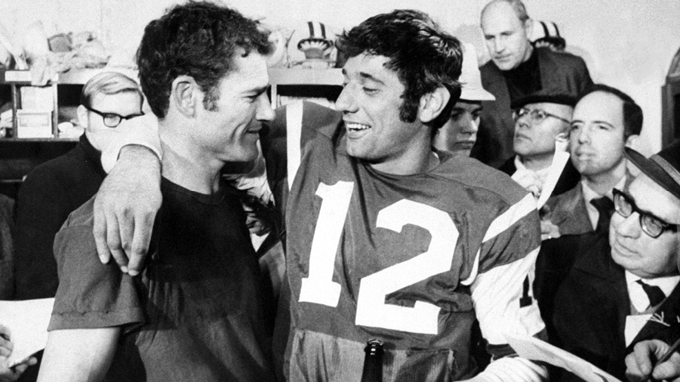 New York Jets' Joe Namath, right, and Don Maynard are surrounded by reporters after winning the AFL Championship, 27-23, over the Oakland Raiders on Dec. 29, 1968, at Shea Stadium in New York. (Photo by Dan Farrell/NY Daily News Archive via Getty Images)
