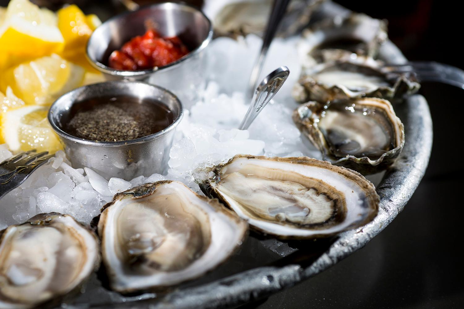 A plate of freshly shucked oysters at Taylor Shellfish's retail shop, located at 2182 Chuckanut Dr, in Bow, Washington. (Sy Bean / Seattle Refined)