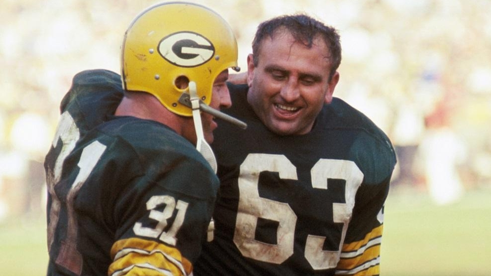 "Running back Jim Taylor of the Green Bay Packers, gets a hug from teammate Fred ""Fuzzy"" Thurston after Taylor's 14-yard touchdown run put the Packers ahead 14-7 in the second quarter of Super Bowl I on Jan. 15, 1967, against the Kansas City Chiefs at the Coliseum in Los Angeles. (Photo by Kidwiler Collection/Diamond Images/Getty Images)"