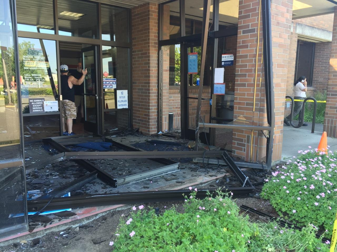 Police say a vehicle drove into the post office on Tyinn Street in west Eugene Tuesday afternoon. The vehicle then backed out of the building and struck another vehicle, they say. (SBG photo)