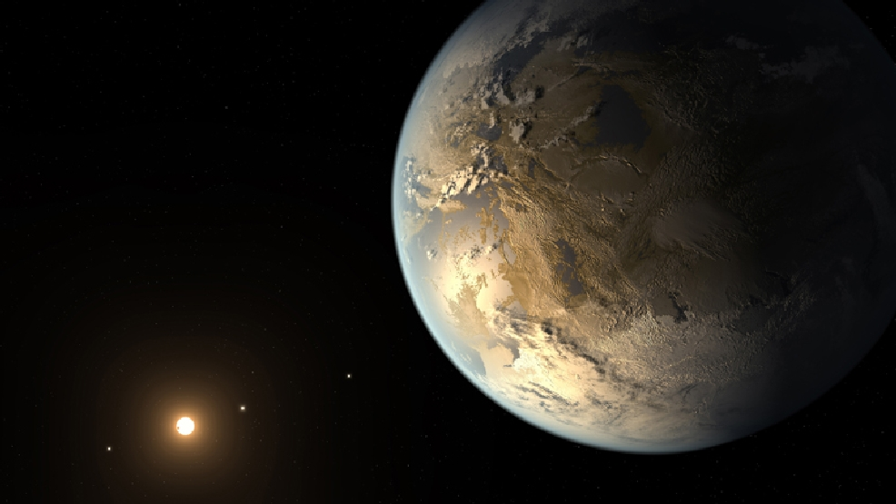 This artist's rendering provided by NASA on Thursday, April 17, 2014 shows an Earth-sized planet dubbed Kepler-186f orbiting a star 500 light-years from Earth. Astronomers say the planet may hold water on its surface and is the best candidate yet of a habitable planet in the ongoing search for an Earth twin. (AP Photo/NASA Ames, SETI Institute, JPL-Caltech, T. Pyle)
