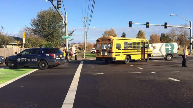 Crash in Eugene involving school bus and van results in minor injuries