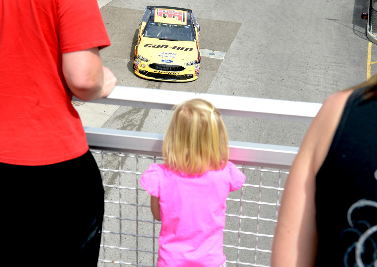 Little Hailey Mauker watches as Matt DiBenedetto's #32 passes under her on his way to the track during NASCAR Stratosphere Pole Day at Las Vegas Motor Speedway. Friday, March 10, 2017. (Glenn Pinkerton/Las Vegas News Bureau)