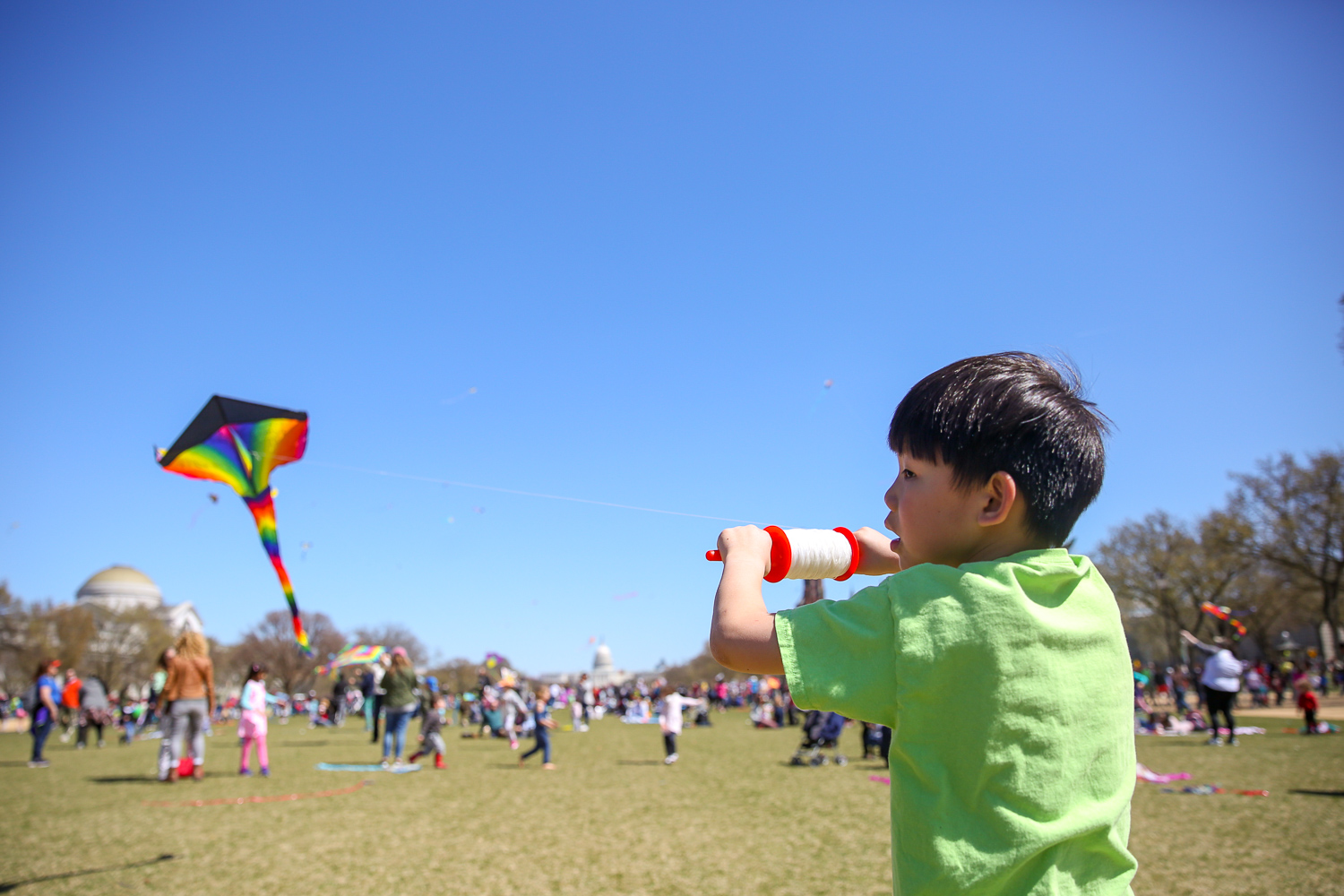 Kids and kids at heart are swarming The Mall for the annual{ } Blossom Kite Festival today. The beloved D.C. tradition encourages people to dust off their kites and let them fly as a part of the National Cherry Blossom Festival. (Amanda Andrade-Rhoades/DC Refined)
