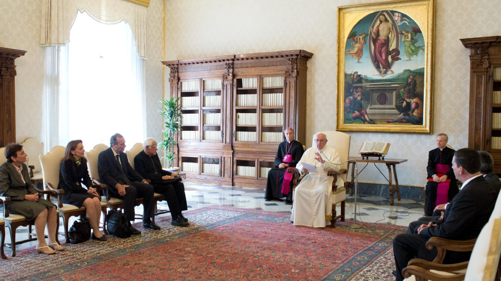 In this photo released by Vatican newspaper L'Osservatore Romano, Pope Francis meets members of the International Catholic Child Bureau, at the Vatican Friday, April 11, 2014. (AP Photo/L'Osservatore Romano)