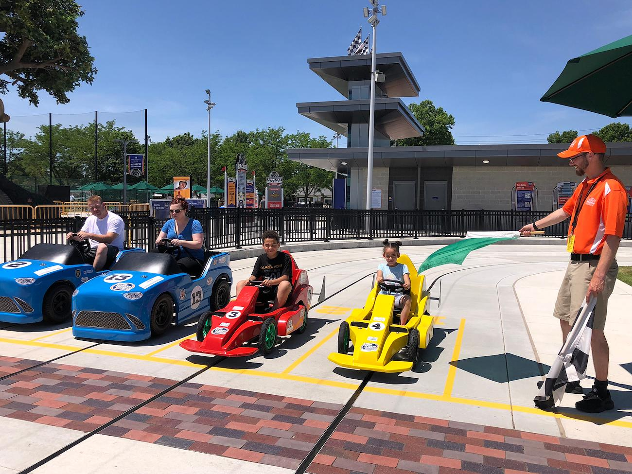 Race pedal cars in the Indianapolis Motor Speedway Pedal Car Racing Experience / Image courtesy of Children's Museum of Indianapolis // Published: 4.2.19