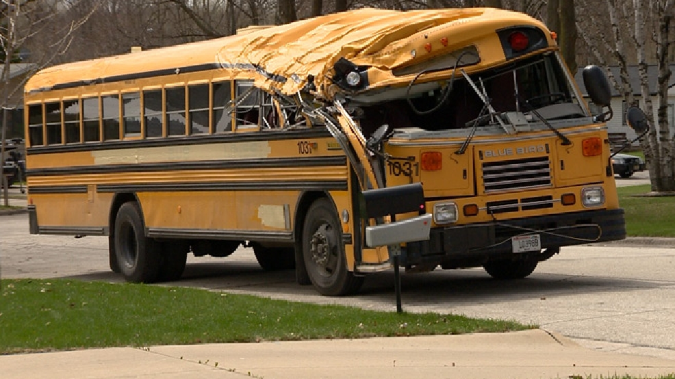 A school bus is seen on Aspen Ln. in Green Bay May 5, 2014, after hitting a tree. (WLUK/Don Steffens)