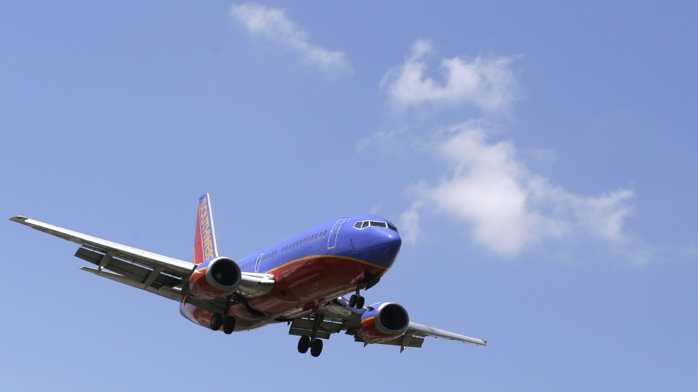 In this June 4, 2014 photo, a Southwest Airlines Boeing 737 comes in for a landing at Love Field in Dallas. (AP Photo/LM Otero)