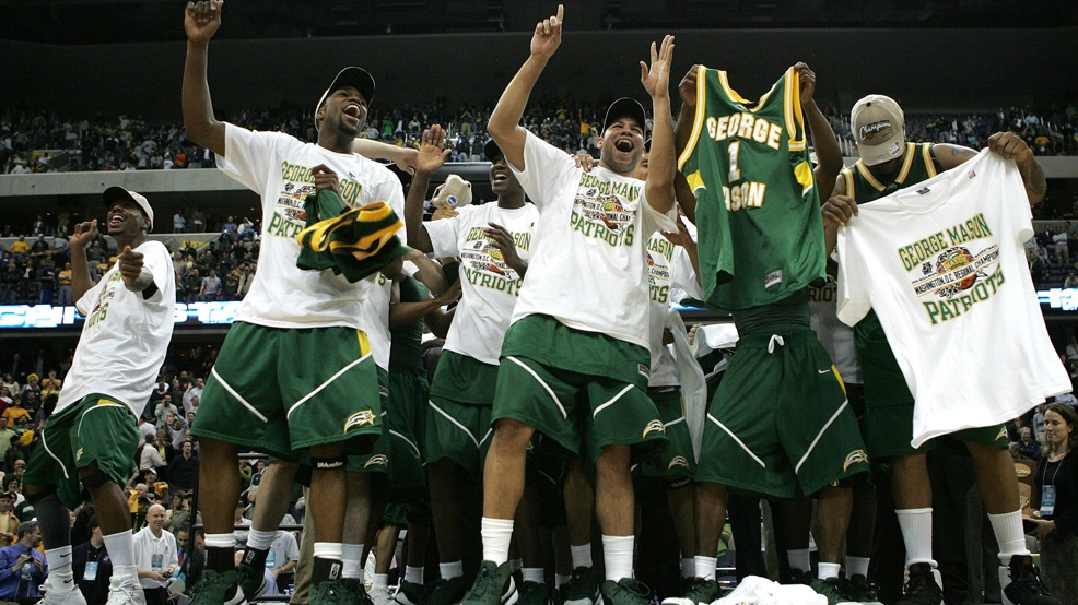 George Mason celebrates their win over UConn in the Washington, D.C., Regional finals of the NCAA Tournament on March 26, 2006 at the Verizon Center in Washington, D.C. The Patriots won in overtime, 86-84.  (Photo by Win McNamee/Getty Images)